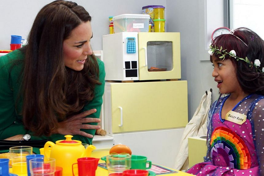Bailey Taylor Rupe talks with Catherine, Duchess of Cambridge, as they sit in the playroom of the Waikato Hospice in Hamilton on April 12, 2014. -- PHOTO: REUTERS