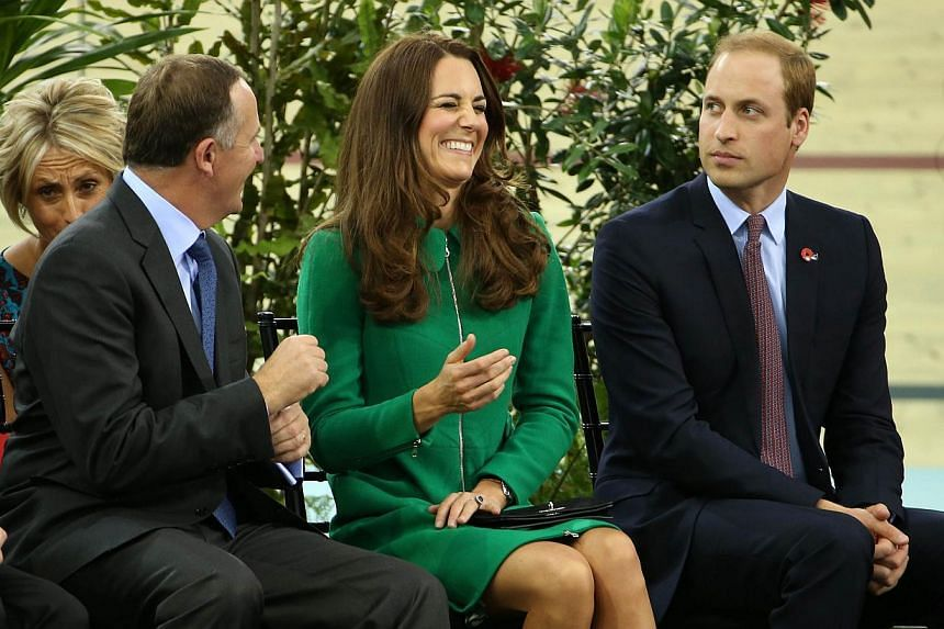 Britain's Prince William (right) and his wife Catherine (centre) speak to Prime Minister John Key (left) as they open the new Avanti Drome, New Zealand's National Cycling Centre of Excellence in Cambridge, Waikato on April 12, 2014. -- PHOTO: AFP
