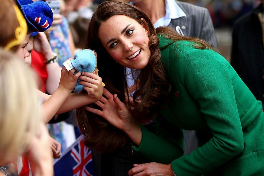 Britain's Catherine, Duchess of Cambridge, reacts as she meets members of the public during a visit with her husband Prince William, in Cambridge on April 12, 2014. -- PHOTO: REUTERS