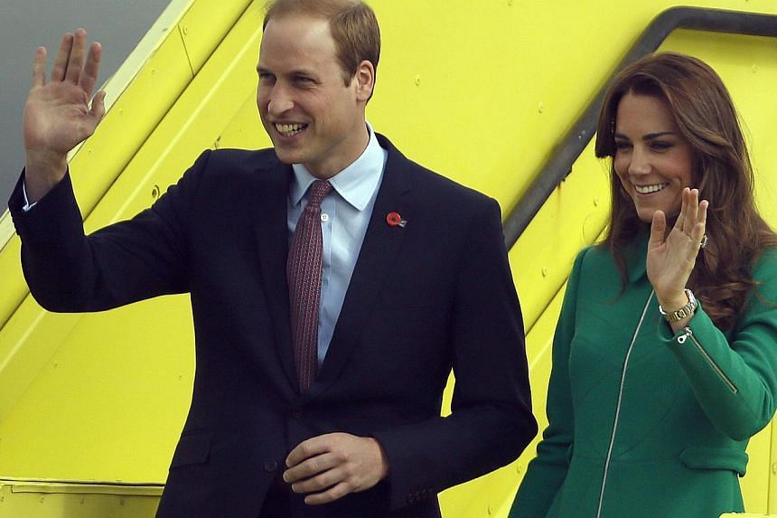 Britain's Prince William and his wife Catherine, Duchess of Cambridge, wave as they arrive at Hamilton airport on April 12, 2014. -- PHOTO: REUTERS