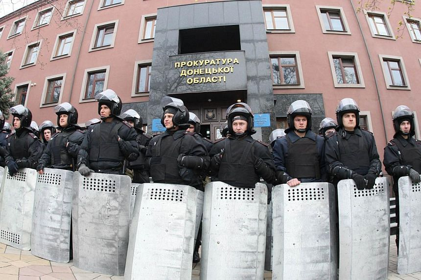 Policemen guard a regional Ukrainian procecutor's office in the eastern Ukrainian city of Donetsk on April 12, 2014. Ex-Soviet countries fearing spillover from the Ukraine crisis have asked Nato for land forces and other backup, potentially movi