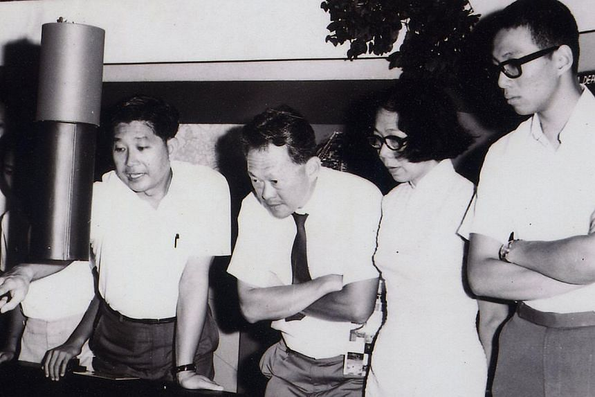 Mr Choe pointing to a model while briefing then PM Lee Kuan Yew, Mrs Lee and their son Hsien Loong on urban renewal. Mr Choe made plans for conservation even as urban development got under way.  Mr Alan Choe says the hard times his generation went th