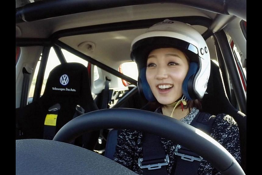 Eunji from Nine Muses races against her teammate Kyungri in Top Gear Korea. -- PHOTO: KIX & KIX HD