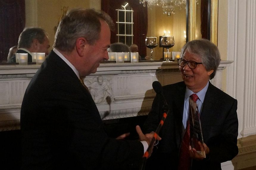Prof Koh (right) receiving the Great Negotiator Award from Professor Jim Sebenius, a negotiations expert at Harvard Business School. The award recognises his contribution to maritime law, among others.