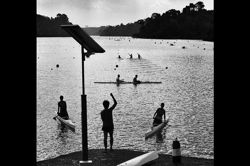 The waters of MacRitchie Reservoir provide a tranquil setting for canoeists in training. -- ST PHOTO: NEO XIAOBIN
