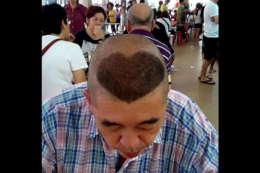 While some people wear their hearts on their sleeves, this man prefers to use his head. -- ST PHOTO: CHEW SENG KIM