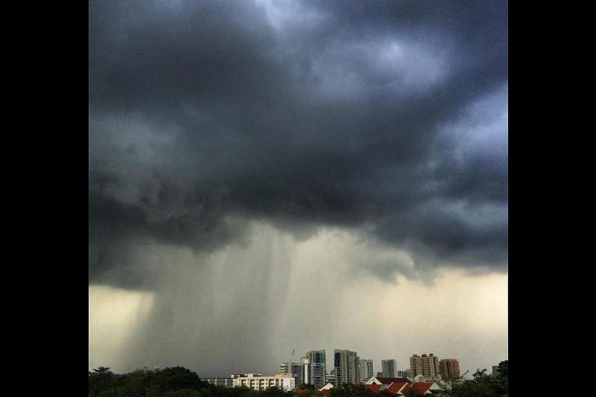 Rain has been scarce in Singapore this year, so these ominous storm clouds over Bishan are a welcome sight for many. -- ST PHOTO: MALCOLM McLEOD