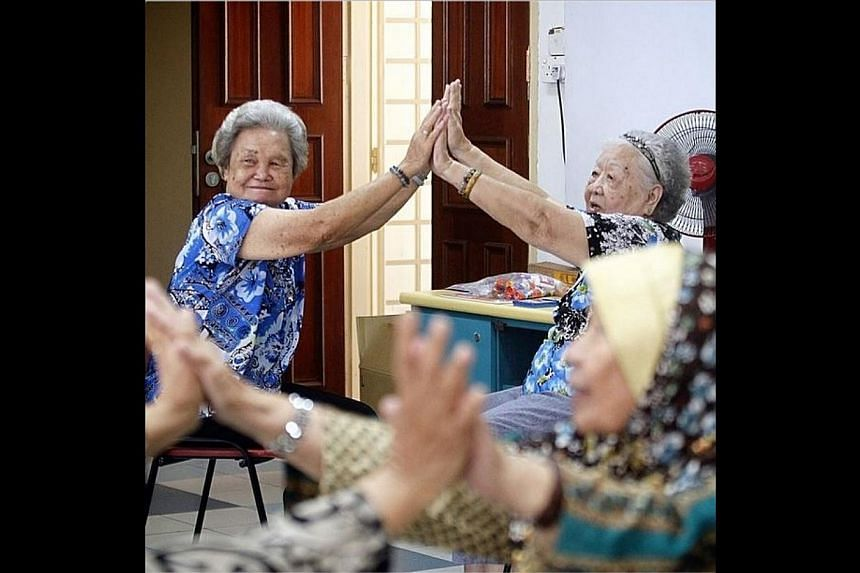 Senior citizens take part in a dance and movement therapy session at the Thye Hua Kwan Bedok Radiance Senior Activity Centre. -- ST PHOTO: KEVIN LIM