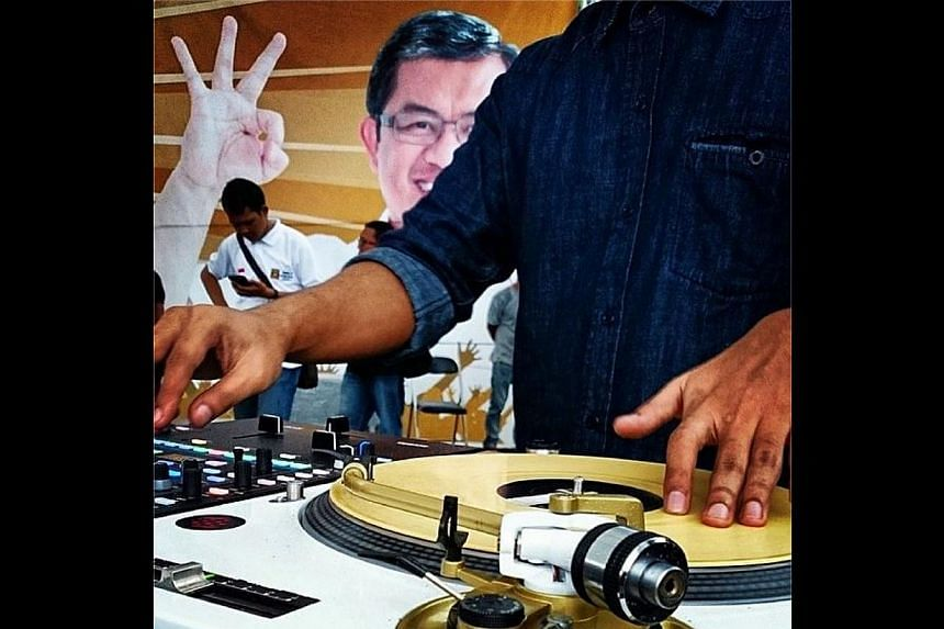 A deejay plays a record at a PKS party rally in Bandung, West Java, Indonesia. -- ST PHOTO: RAJ NADARAJAN