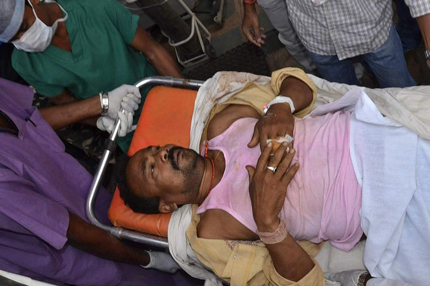 A member of election duty staff who is injured after a bomb blast, is taken to a hospital at Raipur in the eastern Indian state of Chhattisgarh on April 12, 2014. Maoist rebels killed 12 people in two poll-related blasts on Saturday in an insurgency-