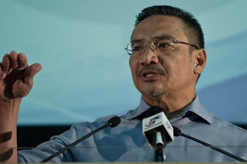 Malaysian Minister of Defence and Acting Transport Minister Hishammuddin Hussein delivers a statement to the media on the missing Malaysia Airlines flight MH370 at the Putra World Trade Center (PWTC) in Kuala Lumpur on April 5, 2014. The Governm