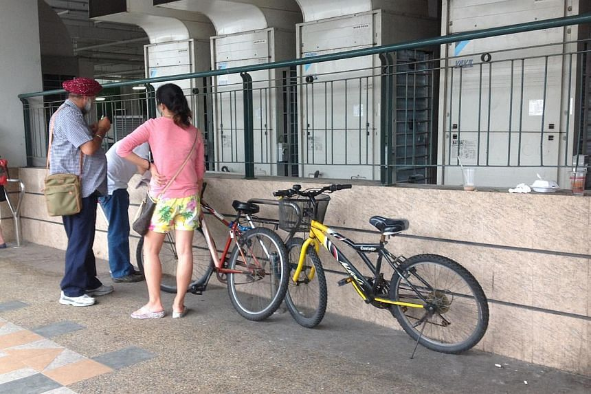 Plain-clothes NEA officers on the prowl for litterbugs at Woodlands during Saturday's littering enforcement blitz. -- ST PHOTO: AUDREY TAN