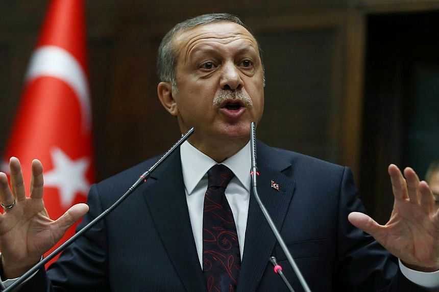 "Turkey's prime minister Recep Tayyip Erdogan said Saturday, April 12, 2014, he will ""go after"" Twitter, accusing the site of tax-evasion, after it was used to spread damaging leaks implicating his inner circle in corruption scandals. -- FILE PHO"