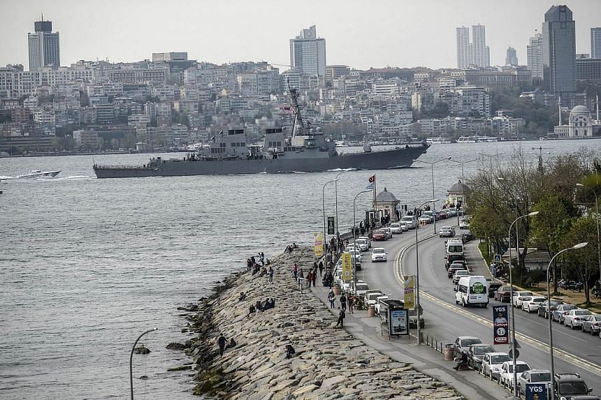 """US warship USS Donald-Cook sails through the Bosphorus in Istanbul, Turkey, on April 10, 2014, en route to the Black Sea. Turkey on Saturday, April 12, 2014, dismissed as """"out of the question"""" claims from Russia that it had allowed US warships to sta"""