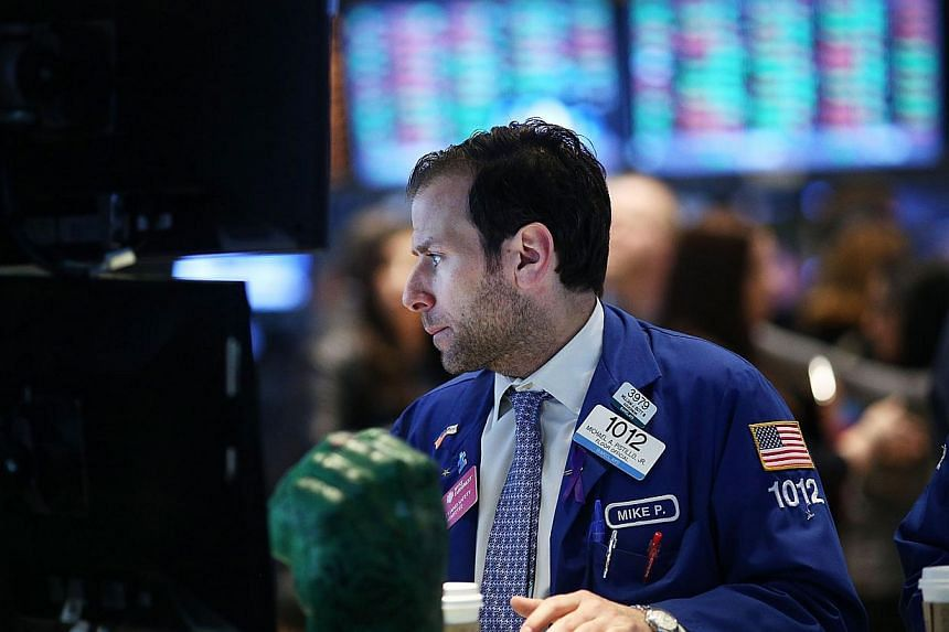 Traders work on the floor of the New York Stock Exchange after ringing the Opening Bell on April 1, 2014 in New York City. The tech-rich Nasdaq Composite Index led Wall Street sharply lower again on April 12, 2014, closing out a dreary week at its lo