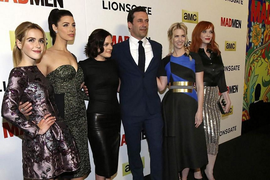 Mad Men star Jon Hamm poses with co-stars (from left) Kiernan Shipka, Jessica Pare, Elisabeth Moss, January Jones and Christina Hendricks at the premiere for the show's seventh season in Los Angeles, California on April 2, 2014. -- PHOTO: REUTER