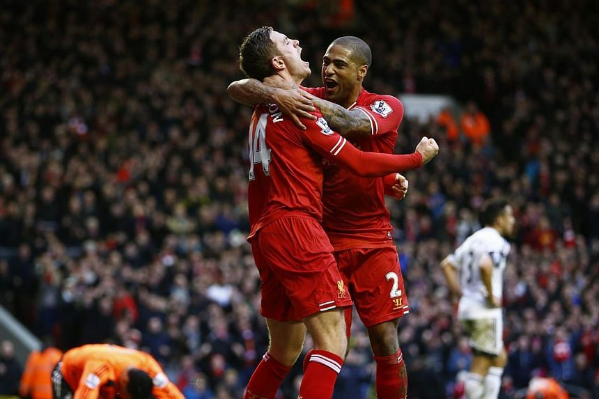 Liverpool's Jordan Henderson celebrates his second goal against Swansea with Glen Johnson (right) during their English Premier League soccer match at Anfield in Liverpool, northern England, February 23, 2014. -- PHOTO: REUTERS