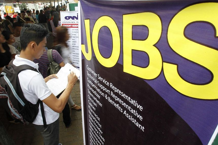 Job seekers attending a job fair in Manila last month. While young people are often advised to follow their passion, some financial writers think that is bad career advice. -- PHOTO: REUTERS