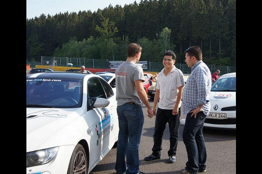 Mr Edmund Tan (middle) with an instructor from RSR Nurburg (left) and another car enthusiast on the Nurburgring race track in Germany. -- PHOTO: COURTESY OF EDMUND TAN