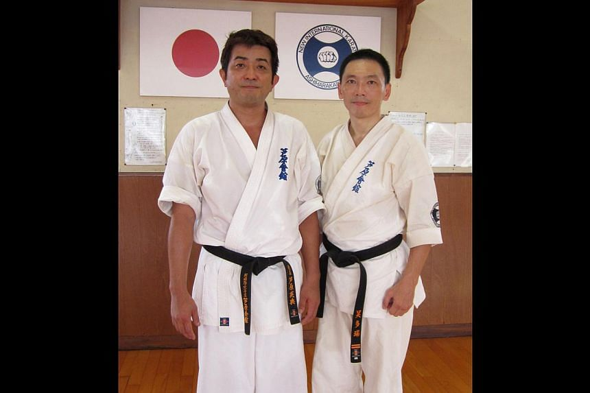 Mr James Goh (right) enjoys learning from Mr Hidenori Ashihara (left), head of Ashihara Karate Kaikan on Matsuyama island in Japan. -- PHOTO: COURTESY OF JAMES GOH