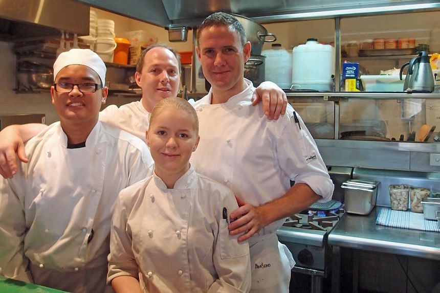 Apprentice chefs Kenneth Yap and Emily Burnell (in front) with their workplace supervisors Richard Learmonth and Mark Haines (at back, from left). Emily works four days a week at The Restaurant Pendolino in Sydney and attends lessons at a Tafe Colleg