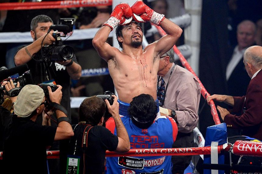 Manny Pacquiao celebrates his victory over Timothy Bradley (not pictured) after their WBO World Welterweight Title bout at MGM Grand Garden Arena. -- PHOTO: REUTERS