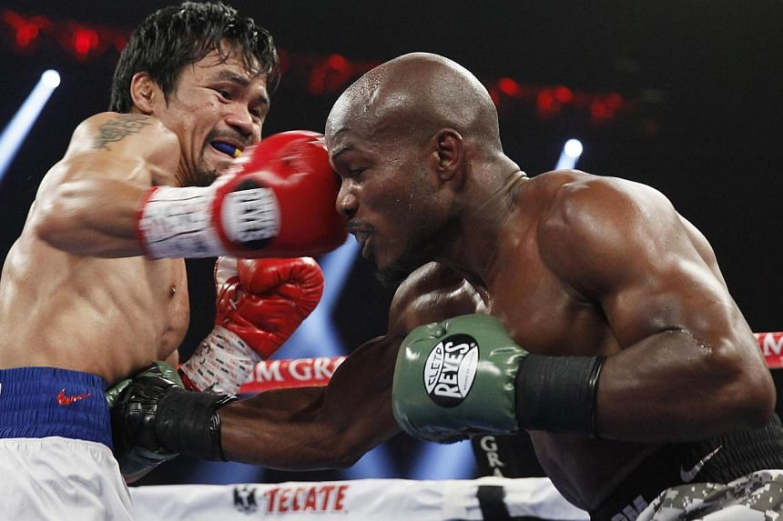 Manny Pacquiao of the Philippines hits undefeated WBO welterweight champion Timothy Bradley of the United States with a right during their title fight at the MGM Grand Garden Arena in Las Vegas, Nevada, on April 12, 2014. -- PHOTO: REUTERS