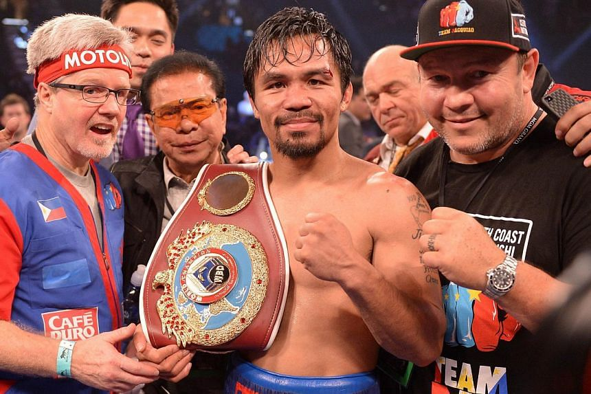 Manny Pacquiao lands a right hand on the head of Timothy Bradley at the MGM Grand Garden Arena in Las Vegas, Nevada, on April 12, 2014. -- PHOTO: AFP