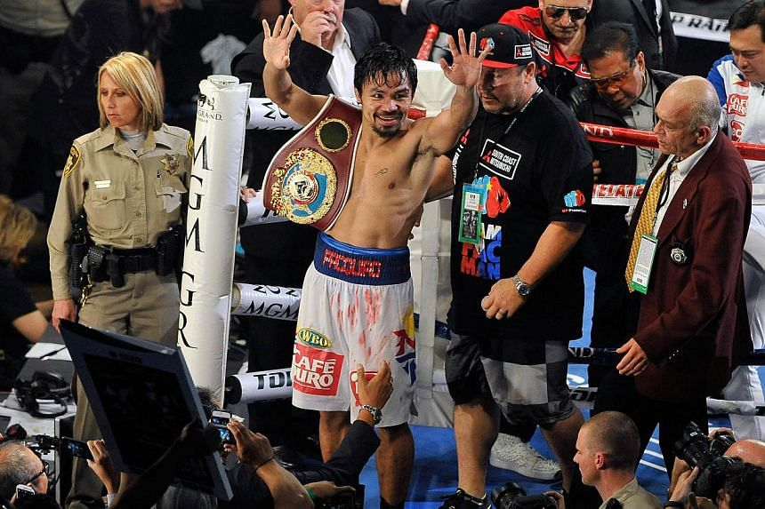 Manny Pacquiao celebrates after his unanimous decision victory over Timothy Bradley during their WBO world welterweight championship boxing match at the MGM Grand Garden Arena in Las Vegas, Nevada, on April 12, 2014. -- PHOTO: AFP