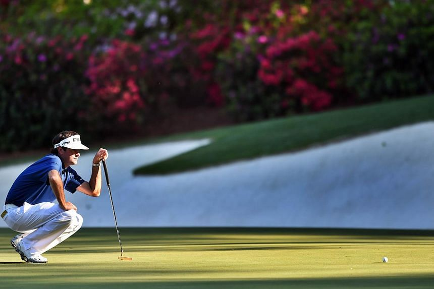 Bubba Watson of the US lines up a putt shot on the 13th green during the third round of the 78th Masters Golf Tournament at Augusta National Golf Club on April 12, 2014 in Augusta, Georgia. -- PHOTO: AFP