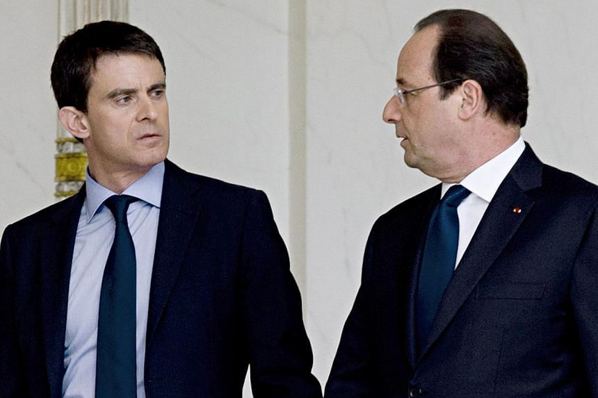 France's President Francois Hollande (right) escorting newly appointed Prime Minister Manuel Valls at the Elysee presidential palace in Paris after the weekly cabinet meeting on April 4, 2014. -- FILE PHOTO: AFP