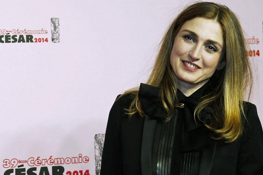 French actress Julie Gayet poses as she arrives at the 39th Cesar Awards ceremony in Paris on Feb 28, 2014. -- FILE PHOTO: REUTERS