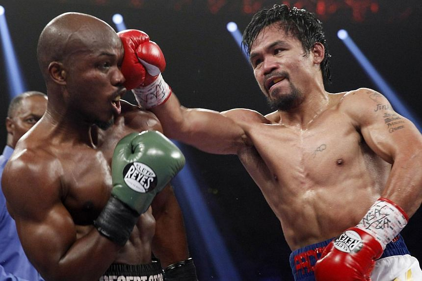 Manny Pacquiao (right) of the Philippines hits undefeated World Boxing Organization welterweight champion Timothy Bradley of the United States with a right during their title fight at the MGM Grand Garden Arena in Las Vegas, Nevada, on April 12, 2014