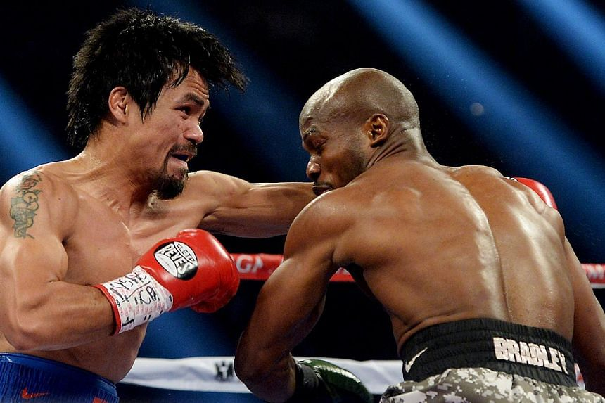 Manny Pacquiao (right) and Timothy Bradley Jr during their WBO World Welterweight Championship fight at MGM Grand Garden Arena on April 12, 2014. -- PHOTO: REUTERS