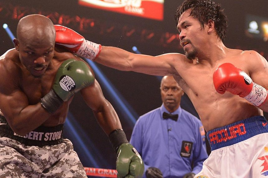 Timothy Bradley of United States (left) defends against Manny Pacquiao of Philippines during their WBO World Welterweight Championship title match at the MGM Grand Arena in Las Vegas, Nevada on April 12, 2014. -- PHOTO: AFP
