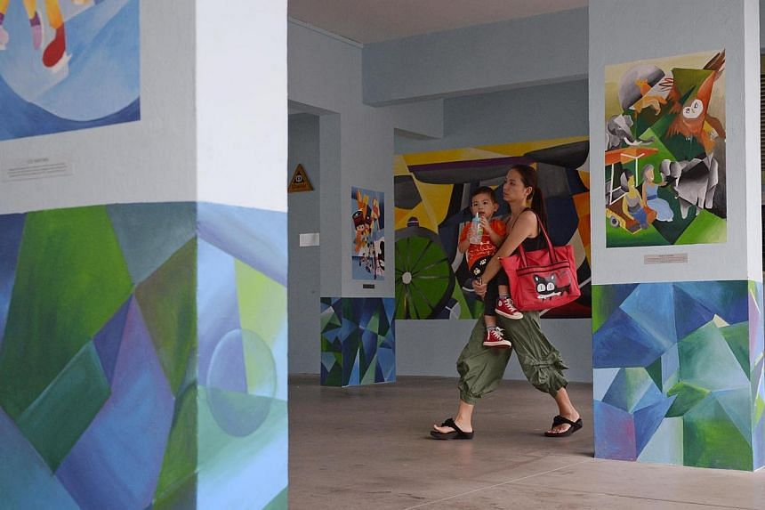 A woman and her child walk pass the Void Deck Art Gallery @ Gek Poh Ville on April 13, 2014. -- ST PHOTO: MARK CHEONG
