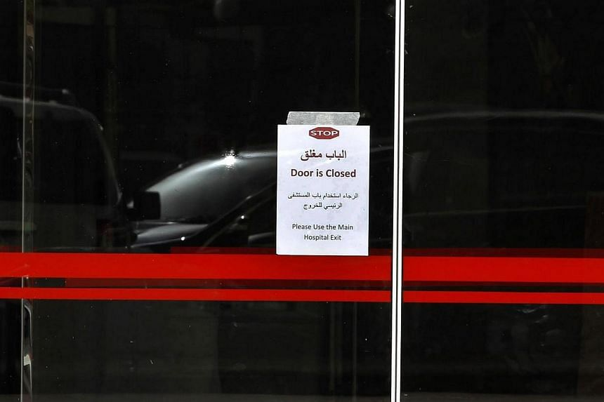 A notice is pastered to the entrace of the emergency department, banning the the exit and entry into the city's King Fahd Hospital on April 9, 2014, in Jeddah.Yemen reported its first case of the deadly Mers coronavirus on Sunday, April 13, 201