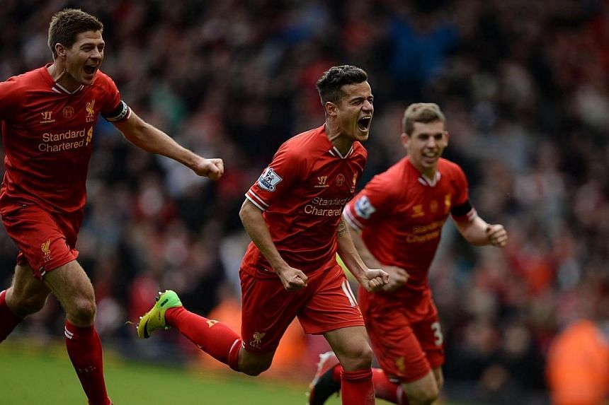 Liverpool's Philippe Courtinho (centre) celebrates scoring with Jon Flanagan (right) and Steven Gerrard against Manchester City during their English Premier League soccer match at Anfield in Liverpool, northern England on Sunday, April 13, 2014.&nbsp