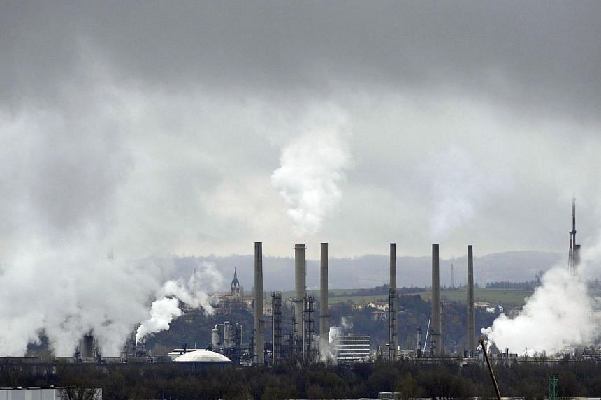 This file picture dated Dec 3, 2009 shows smoke billowing from the chimneys of petrochemical factory on in Feyzin near Lyon, eastern France.Faster action is needed to keep global warming to agreed limits and delays until 2030 could force relian
