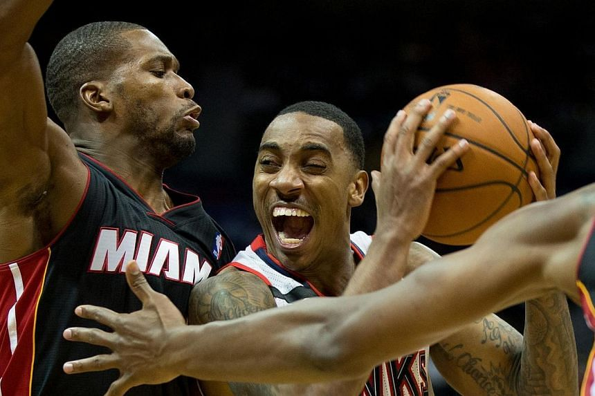 Atlanta Hawks guard Jeff Teague (0) is defended by Miami Heat guard Toney Douglas (0) during the fourth quarter at Philips Arena. The Hawks won 98-85.The Atlanta Hawks clinched the eighth play-off spot in the Eastern Conference on Saturday, Apr