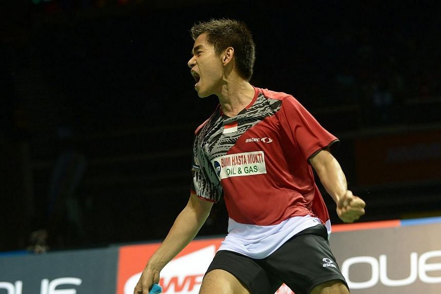 Simon Santoso of Indonesia reacts after defeating world number one Lee Chong Wei of Malaysia during the OUE Singapore Open badminton tournament men's final on Sunday, April 13, 2014.Indonesia's Simon Santoso upset Malaysia's world No. 1 Lee Cho