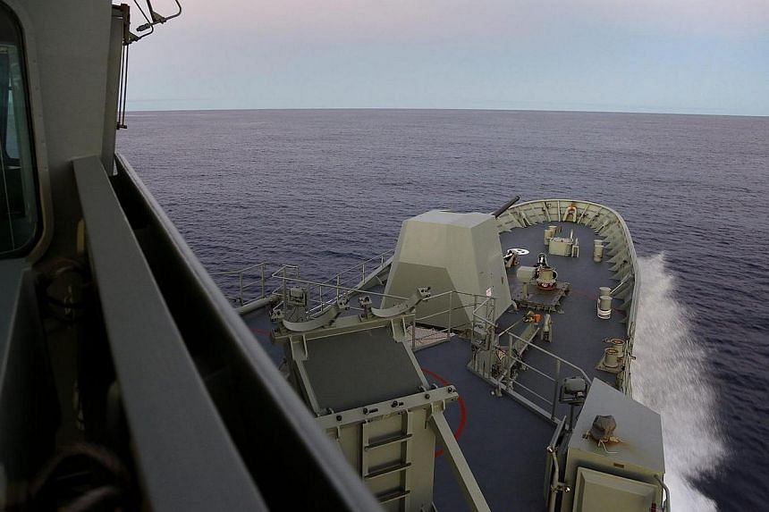 HMAS Toowoomba making her way through the calm waters of the Indian Ocean at speed during the search for missing Malaysia Airways Flight MH370 on April 8, 2014.Malaysia on Sunday, April 13, 2014, rejected claims that phone calls were made from