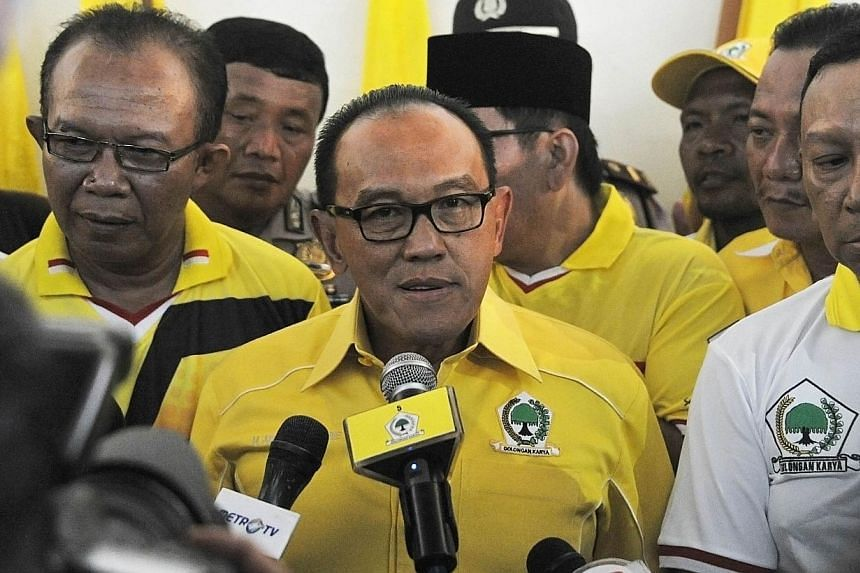 President candidate from the Golongan Karya (Golkar) party, an Indonesian tycoon Abu Rizal Bakrie, delivers his speech during the first week of campaigning for the legislative election in Jakarta on March 18, 2014.The Golkar Party, which came i