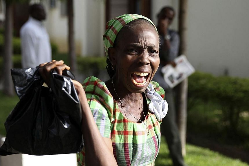 A bystander reacts as she sees victims of a bomb blast arriving at the Asokoro General Hospital in Abuja on April 14, 2014. -- PHOTO: REUTERS