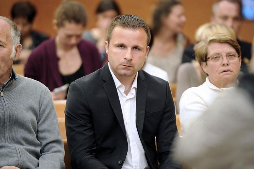 "Nicolas Cano (center) attends the trial of Manuela Gonzalez nicknamed ""the black widow"", a 53-year-old woman accused of having killed his father Daniel Cano in 2008, on April 14, 2014 at the Grenoble courthouse. A former driving instructor dubbe"