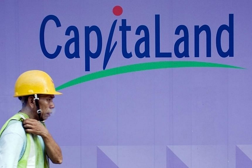 A laborer walks in front of a Capitaland logo at a construction site in Singapore on Friday, Oct. 31, 2008.CAPITALAND has offered to buy up all shares of CapitaMalls Asia (CMA), a listed mall owner and operator, that it does not own. -- FILE PH