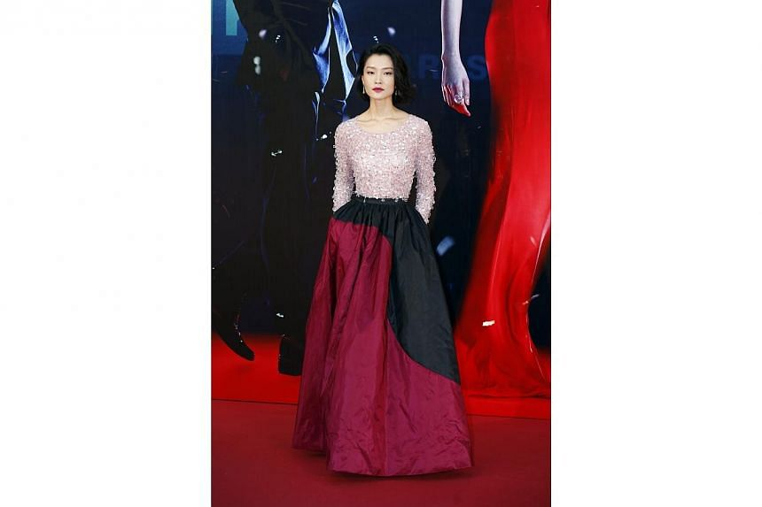 "Chinese actress Du Juan, nominated for Best New Performer for her role in ""American Dreams In China"", poses on the red carpet during the 33rd Hong Kong Film Awards in Hong Kong on April 13, 2014 -- PHOTO: REUTERS"