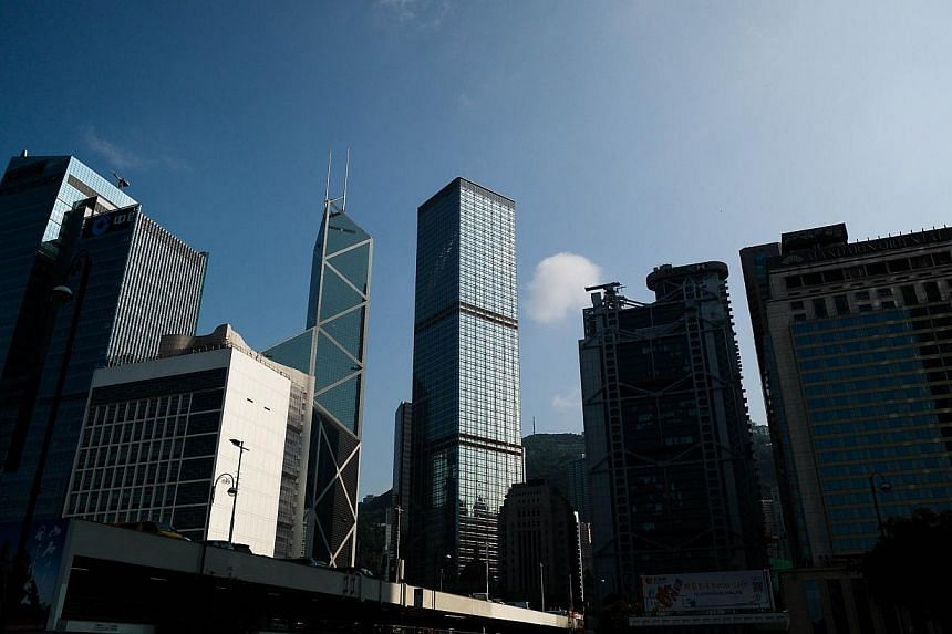 High rise buildings are seen in the financial district of Hong Kong on April 10, 2014.Hong Kong shares finished slightly higher on Monday, April 14, 2014, in subdued trade, with a strong performance from blue chips including Hong Kong Exchanges