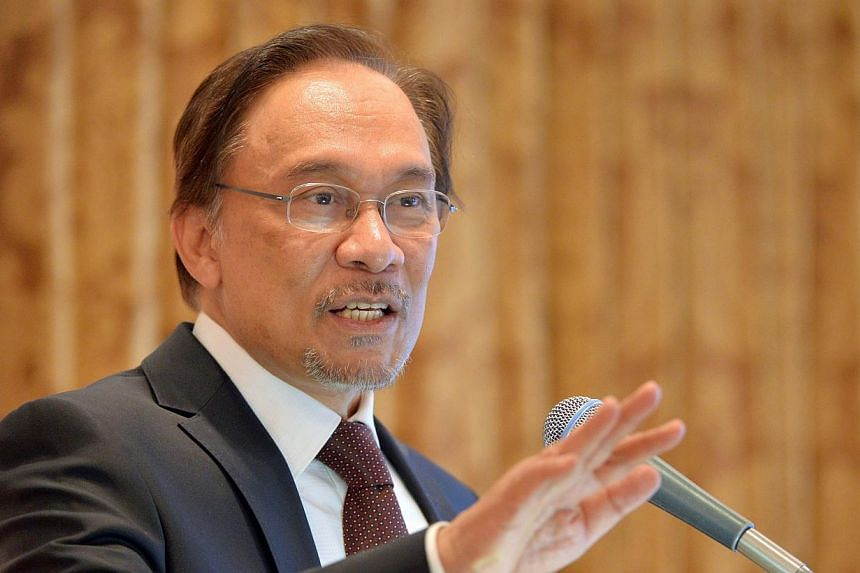 Malaysia's opposition leader Anwar Ibrahim delivers a speech during a lecture hosted by Japan's Sasakawa Peace Foundation in Tokyo on February 27, 2014.Malaysia's opposition on Monday, April 14, 2014, denounced what it called a government bid t