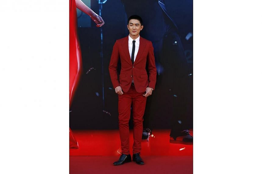 "Lin Gengxin, nominated for Best New Performer for his role in ""Young Detective Dee: Rise Of The Sea Dragon"", poses on the red carpet during the 33rd Hong Kong Film Awards in Hong Kong on April 13, 2014. -- PHOTO: REUTERS"